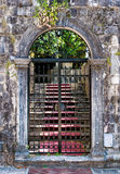 Old closed wrought-iron gates Stock Image
