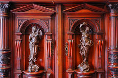 Old closet. Beautiful old wooden closet with sculptures stock image
