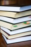 Old closeup books with colored paper sign. Stacked books closeup on wood table Stock Photo