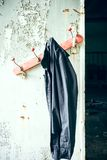 Old clothes wardrobe with jacket. An old crooked clothes wardrobe with a black jacket Royalty Free Stock Photos