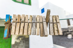 Old clothespin under blue sky Royalty Free Stock Image