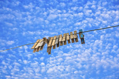 Old clothespin under blue sky i Stock Photo