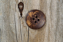 Old clothing button on rustic wood Royalty Free Stock Photo