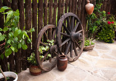 Old coach wheel around barn. Bulgaria Royalty Free Stock Photo