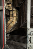 The old coal boiler grate without one wall Stock Images