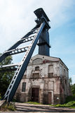 Old coal mine shaft with mining tower Stock Images