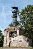 Old coal mine shaft with a mining tower Stock Images