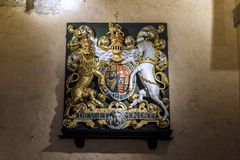 The old coat of arms of Britain. LONDON, GREAT BRITAIN - MAY 16, 2014: This is the old medieval coat of arms of Britain from the Tower of London Royalty Free Stock Photos