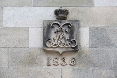 Old coat of arms 1836 at the castle. Stock Photos