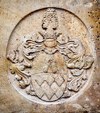 Old coat of arms. At a church Stock Photos