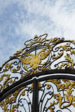 Old coat of arms of the Russian Empire on the gate Stock Photos