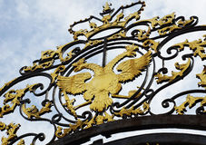 Old coat of arms of the Russian Empire over the gate Stock Photos