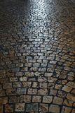 Old cobble stone road surface background texture vertical Royalty Free Stock Photos