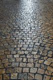 Old cobble stone road surface night light reflections background Stock Photography