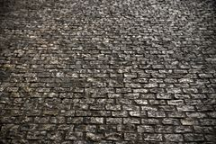 Old cobble stone road surface paving background texture Stock Images