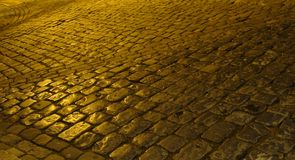Old cobble stone street rainy night Royalty Free Stock Images