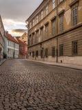 Old cobble street in Prague Castle district. Old cobble Loretanska street in Hradcany district, Prague, Czech Republic stock photography