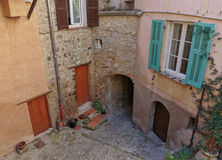 Old cobbled patio with flowers in the old town Coaraze. In France stock photo