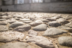 Old cobbled pavement of cobblestones in the city in the backgrou Stock Photo