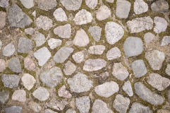 Old cobbled stone pavement of cobblestones in the city. Stock Images