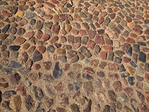 Old cobbled stones road background Stock Photo
