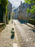 Old cobbled street on Montmartre hill in Paris Stock Images