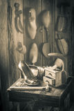 Old cobbler workplace with brush and shoes Stock Photos
