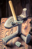 Old cobbler workplace with tools, leather and shoes Royalty Free Stock Photography