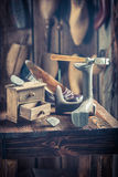 Old cobbler workshop with tools, shoes and laces Royalty Free Stock Photo