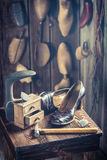 Old cobbler workshop with tools, shoes and leather Stock Image