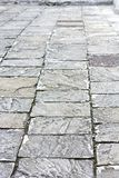 Old Cobbles. Ancient cobblestone pavement in the old town Stock Image