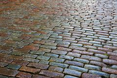 Old cobbles on the road. Old cobbles on the city road royalty free stock photography