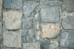 Old cobbles pattern, cobblestone texture, close up view, stone background Royalty Free Stock Images