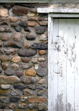 Old Cobblestone Building. And white door stock image