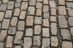 Old Cobblestone Path. A background of weathered and worn old cobblestones Stock Photography