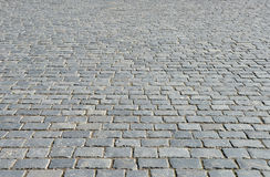 Old cobblestone pavement. Royalty Free Stock Photo