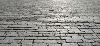 Old cobblestone pavement. Abstract background of old cobblestone pavement close-up stock photography