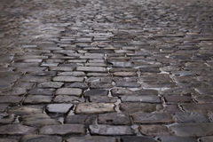 Old cobblestone after the rain Royalty Free Stock Photo