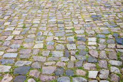 Old cobblestone road as a background. Stock Photo