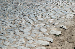 Old cobblestone road paved with stones Stock Photo