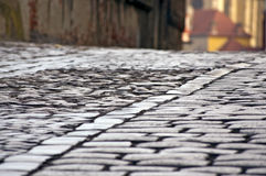 Old cobblestone and sett street Royalty Free Stock Image