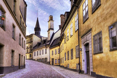 Old cobblestone street. Cobblestone street with old beautiful buildings stock photos