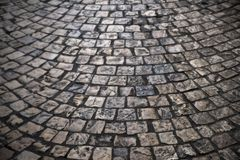 Old cobblestone street background texture backlighting Stock Images