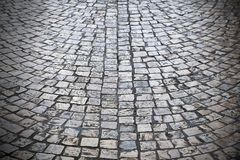 Old cobblestone street background texture dark vignette Stock Photography