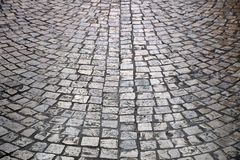 Old cobblestone street background texture light reflection backlight Royalty Free Stock Photography