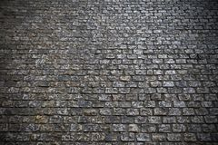 Old cobblestone street dark night background texture Royalty Free Stock Photos
