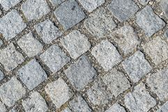 Old cobblestone street in the city.  Royalty Free Stock Photos