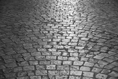 Old cobble stone street dark night background texture Royalty Free Stock Images