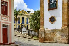 Old cobblestone street with houses in colonial architecture. In the famous city of Ouro Preto in Minas Gerais royalty free stock photos