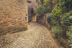 Old cobblestone street in the medieval city of Bruniquel Stock Photos